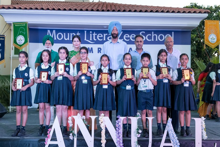 Mount Litera Zee School-Trophies to the Students
