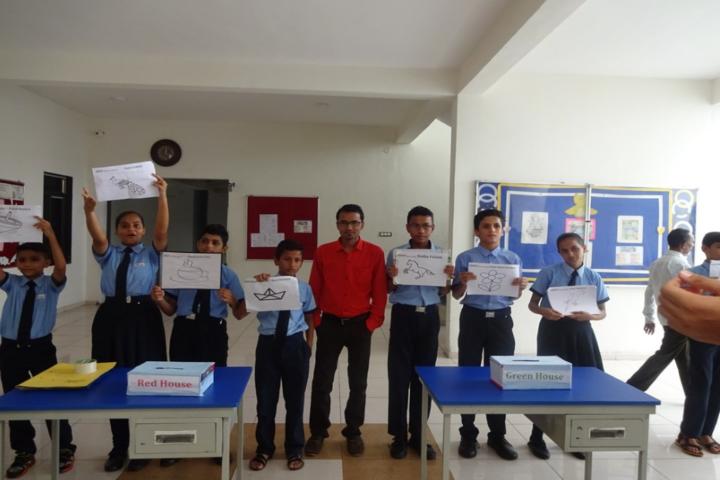 Blue Moon International School,Karjan-Houses Compitation