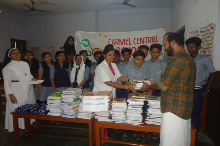 Carmel Central School-Note Books And Pen Donation Activity